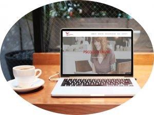 Psicología Online - Portátil y cafe redondeado